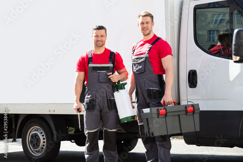 fototapeta na ścianę Portrait Of A Smiling Young Male Technicians Holding Tool Box