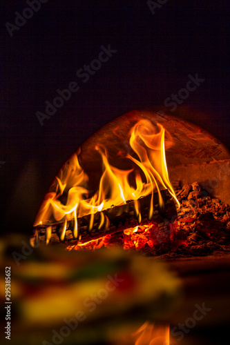 Wood burning fire oven with pizza Fototapet