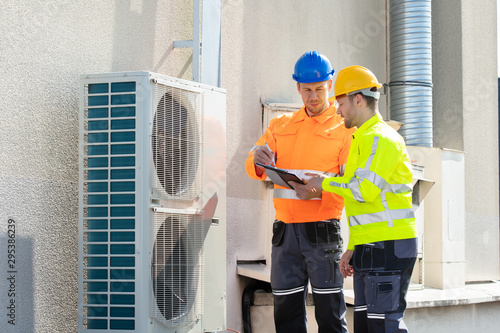 Fotografie, Tablou An Electrician Men Checking Air Conditioning Unit