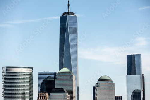 Low angle view of One World Trade Center in city against blue sky Wallpaper Mural