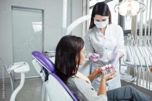 Fototapeta A woman is preparing for a dental examination. Woman having teeth examined at dentists.  obraz na płótnie