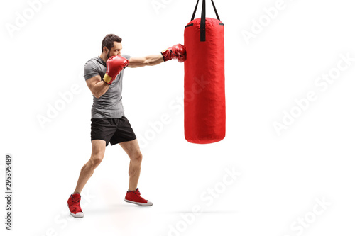 Man punching a bag with boxing gloves