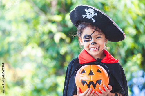 Cute asian child girl wearing halloween costumes and makeup having fun on Hallow Slika na platnu