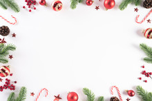 Christmas Background Concept. Top View Of Christmas Green Gift Box With Candy Cane, Snowflakes, Red Berries And Bell On White Wooden Background.