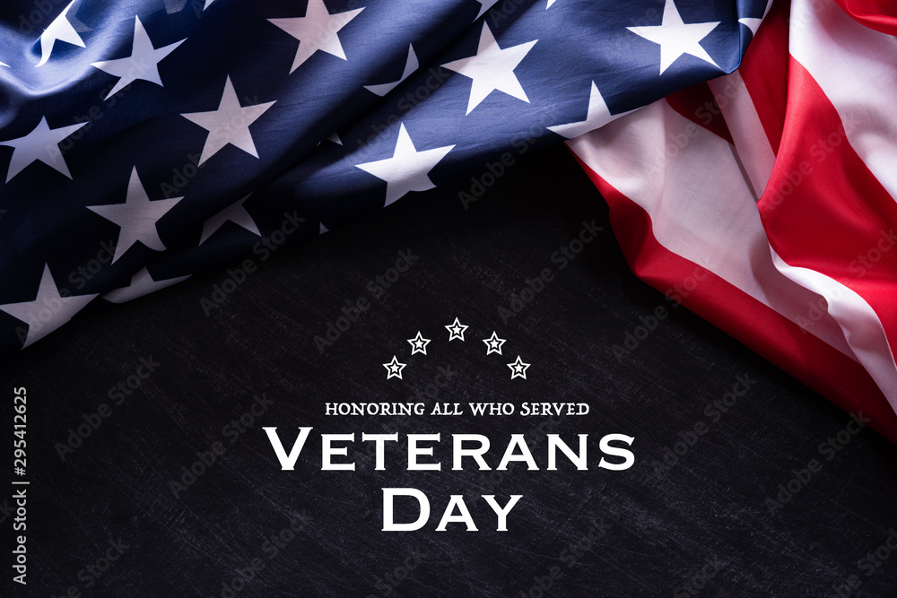 Fototapeta Happy Veterans Day. American flags with the text thank you veterans against a blackboard background. November 11.