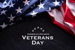 canvas print picture - Happy Veterans Day. American flags with the text thank you veterans against a blackboard background. November 11.