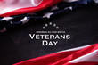 canvas print picture - Happy Veterans Day. American flags veterans against a blackboard background.