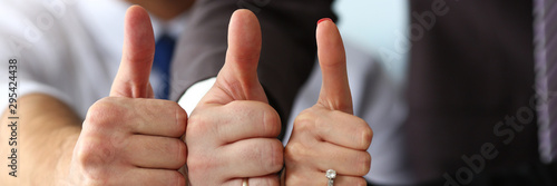 Photo Group of people show OK or confirm with thumb up during conference closeup