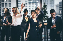 A Group Of Business People Hol...