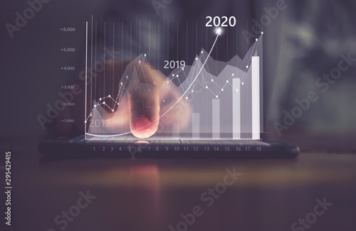 Fotografía  Augmented reality (AR) financial charts showing growing revenue In 2020 floating