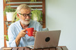 canvas print picture - Portrait senior man using laptop for working at home, Freelance concept - Image