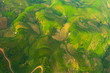 Leinwanddruck Bild - Aerial top view of paddy rice terraces, green agricultural fields in countryside or rural area of Mu Cang Chai, Yen Bai, mountain hills valley at sunset in Asia, Vietnam. Nature landscape background.