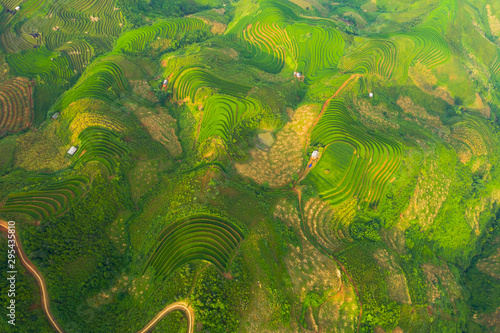Autocollant pour porte Les champs de riz Aerial top view of paddy rice terraces, green agricultural fields in countryside or rural area of Mu Cang Chai, Yen Bai, mountain hills valley at sunset in Asia, Vietnam. Nature landscape background.