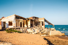 Ruined House On The Beach Afte...