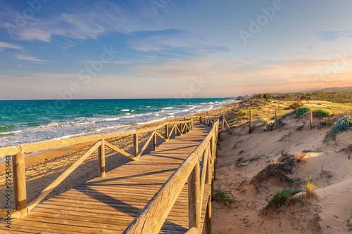 wooden footbridge descending towards the guardamar beach in Alicante Fotobehang