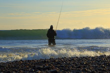 Surf Fishing On The Jurassic Coast Near Seaton In Devon