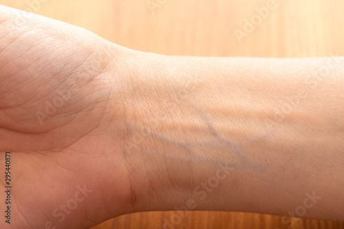 Human wrist with blue veins visible through skin close up Wallpaper Mural