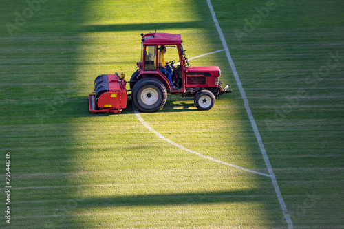 Obraz na plátne  Man in tractor aerating a soccer field