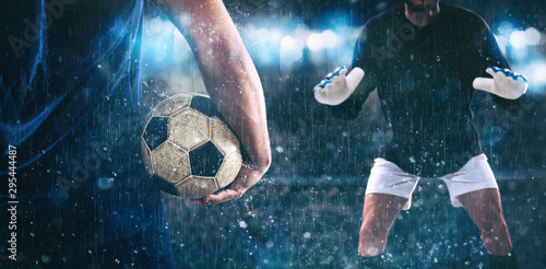 Fotografía  Soccer scene at night match with close up of a soccer striker holding the ball a