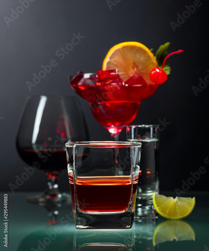 Fotografie, Obraz  Various alcoholic drinks on a black background.