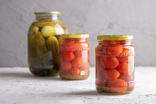 Canned Vegetables In Three Glass Jars, Closeup. With Dill And Garlic