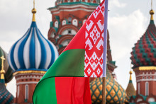 National Flag Of The Republic Of Belarus On The Background Of St. Basil's Cathedral On Red Square In The Center Of Moscow, Russia