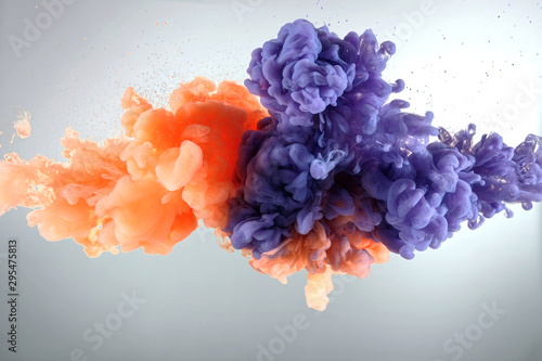 Orange and purple paint splash isolated on white background - 295475813