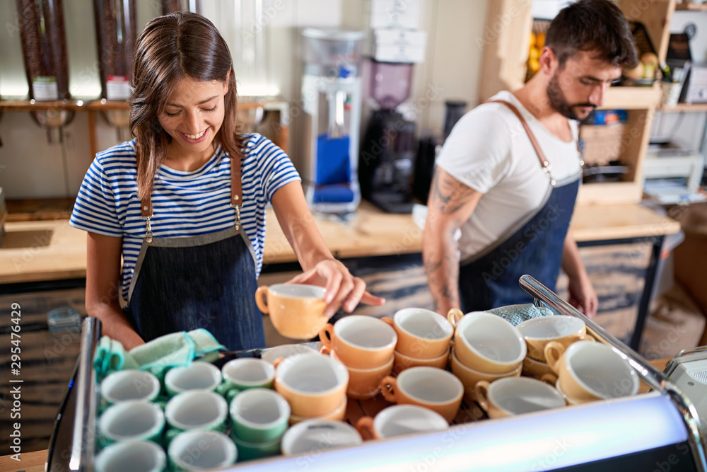 Fototapeta Couple barista working in coffee shop.Coffee business concept.Business owner.
