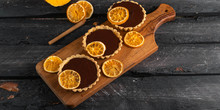Chocolate Orange Tartlets, Dark Wooden Backdrop, Winter Dessert Concept