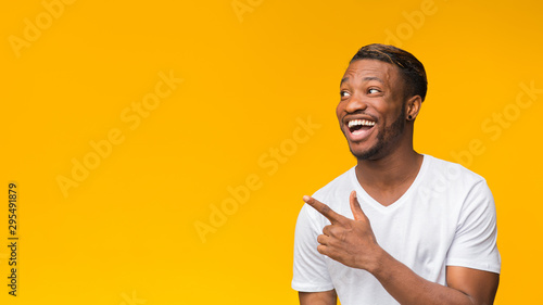 Obraz Excited Afro Man Pointing Finger Aside, Studio Shot, Panorama - fototapety do salonu