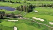 Golf course with gorgeous green and fantastic forest view. Aerial. 4K.