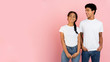 canvas print picture Cute teen couple posing on pink background with free space