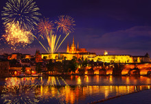 Colorful Massive Fireworks Show Over The Prague Czech Republic. Celebration Concept Christmas, New Years Eve 2020. Panoramic Shot Of The Night City With Lights And Reflection In The Water. December 31