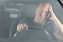 Man In His Car With Hands On Head During Traffic-jam