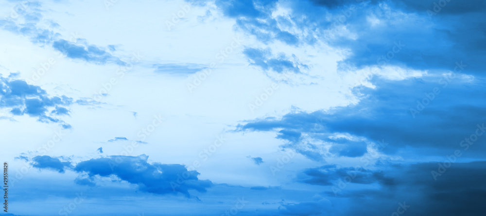 Fototapeta Blue hour sky clouds background. Beautiful landscape with stormy clouds and purple sun on sky