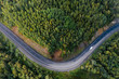 canvas print picture - Top down aerial view of mountain road curve among green forest trees. Small cargo truck on the highway. P-258 road on the shore of Baikal Lake near Baikalsk, Buryatia, Russia
