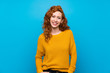 Redhead woman with yellow sweater laughing