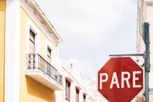 Stop / Pare Traffic Street Sign On Road Intersection In Residential Neighborhood Of Old San Juan City, Puerto Rico