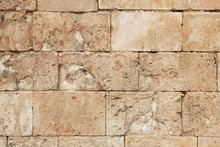 Old And Weathered Large Stone Blocks Wall Texture. Beige Sandstone Tones