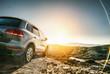 Leinwandbild Motiv SUV car in spain mountain landscape road at sunset