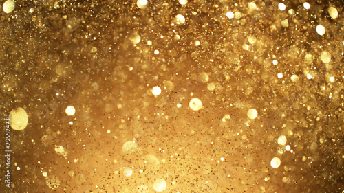 Fototapeta Abstract golden glittering background with blur dots. obraz
