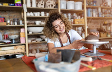 Woman Pottery Artist Makes Cer...