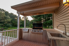Outdoor Kitchen; Grill, Sink, Granite Countertop