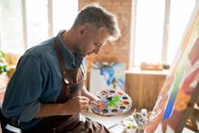 Creative Man In Apron Mixing C...