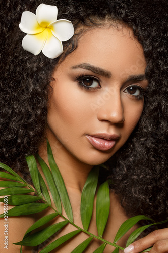 Beauty black skin woman fashion african ethnic female face portrait. Young girl model with afro and tropical leaves in hands