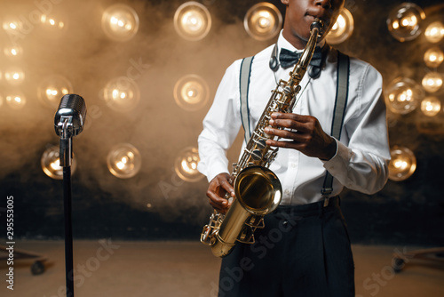 Black jazz performer plays the saxophone on stage Canvas Print