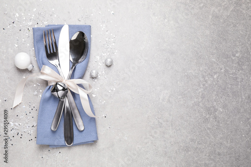 Cutlery set on grey table, top view with space for text. Christmas celebration - 295554009