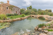 Traditional Old House With Stone Bridge Over A Small Lake, Croatia