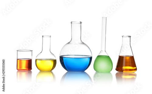 Fototapeta Laboratory glassware with color liquids on white background obraz