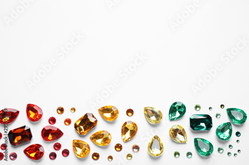 Valokuvatapetti Different beautiful gemstones on white background, top view